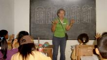 P-WEC's voluntary teacher teaching Math to the 9 year old students